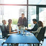 Shot of a group of businesspeople meeting in the boardroom