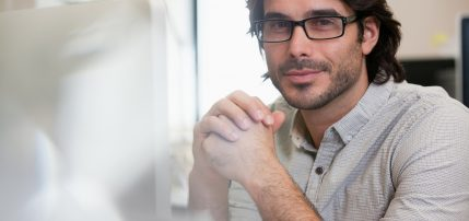Close up portrait of smiling businessman wearing eyeglasses